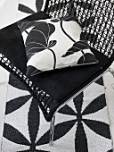 Black and white pillows on a mesh chair