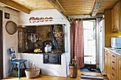 An old kitchen oven with a fireplace extraction hood in a country weekend house
