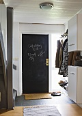A black door and a cloakroom in a stairway