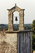 Italian bell tower on an old house