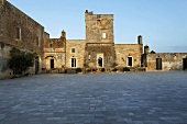 Large stone piazza in an Italian village with historic architecture