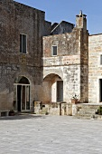 Mediterranean houses with natural stone walls and a paved piazza