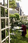 An open glass door - a coffee break in a garden