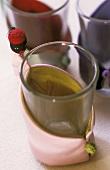 Tea glass in a decorative fabric tea glass holder