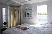 Romantic bedroom on a boat and a view of the riparian landscape, Nile, Egypt
