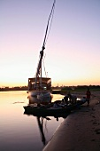 Evening over the river with a boat and rigging on the banks of the River Nile, Egypt