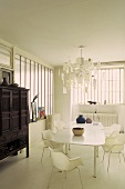 Dining room in a white loft and Asian style antique cupboard