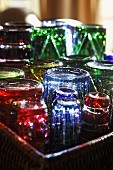 Colorful drinking glasses on a tray