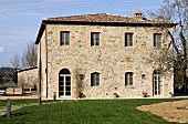 Several storey country home with natural stone facade and a well manicured lawn