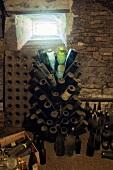 A former wine cellar with dusty bottle racks