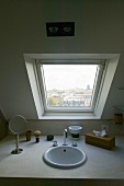 Built in vanity with bathroom accessories under a skylight