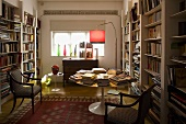 Library with white built-in shelves and antique chairs