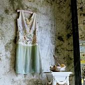 A summer dress on a hanger hanging on a wall