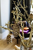Gilded Christmas decorations on golden branch