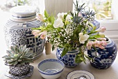 Blue and white Chinese bowls and pots with flowers