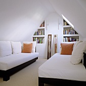 Attic room (minimalist design) with single beds under a pitched roof and built in shelves