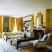 A living room with yellow walls - an antique sofa and a coffee table in front of a fireplace