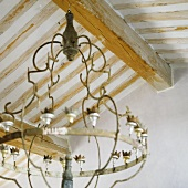 A wood beamed ceiling with a chandelier