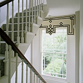 A transom window with a pelmet in a stairway