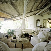 Vacation home in the tropic with rustic wooden roof and view with white sectional sofa