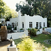 A white house in South Africa with a curved fascia and a terrace