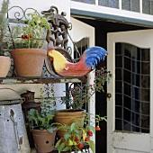 A rusty flowerpot shelf and an open terrace door