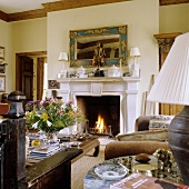 Crackling fire in a fireplace in a living room (country home style decor)