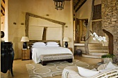 A spacious bedroom with a double bed in a South African house