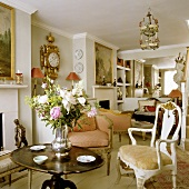An English living room with Rococo-style armchairs and an antique wooden table