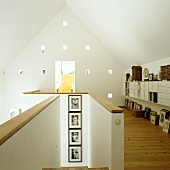 A house with an open stairway and a gallery with a view on a gable wall