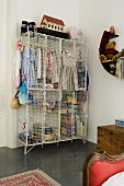 Children's clothes in a cage cupboard