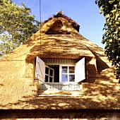 A roof window in a 19th century German thatched-roof house