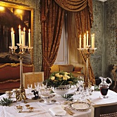 A romantic atmosphere in a palazzo - a festive table set for two