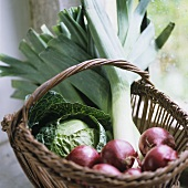 Onions, cabbage and leek in a basket