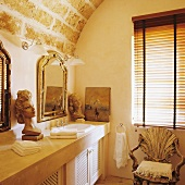 Diffused light in a bathroom with a rustic vaulted ceiling