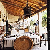 An antiques collection on the terrace of a rustic country house