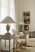 A simple side table with an antique table lamp and a Baroque-style armchair