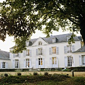 A manor house in France with sorry-looking garden