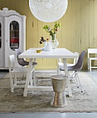 A mixture of styles in a dining room - table and chairs in a country house and Bauhaus style