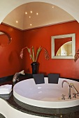 An atmospheric bathroom - a spa pool under a vaulted ceiling with a starry sky and a red-painted wall