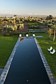 Moroccan landscape - view over a garden pool and an agricultural area