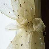 Shells on a natural coloured linen curtain