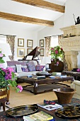 A coffee table and a sofa in a Mediterranean living room with a wood beam ceiling