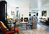 A maisonette apartment - a black and white sofa, a table and a wooden ceiling