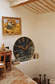 An attic in a country house - a pedestal and a shelf with an antique clock face