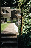 A red brick access path to a Flemish-style villa