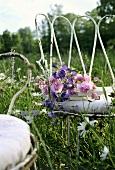 A white garden chair in a meadow