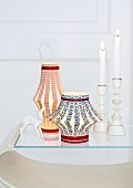 Chinese lanterns and candlesticks with burning candles