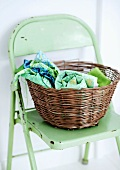 Willow basket on a green folding chair