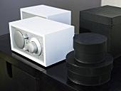 A set of black boxes next to a white radio